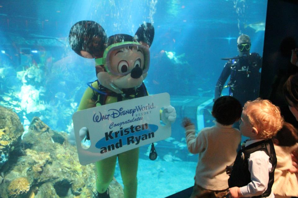 mickey mouse scub diving with sign