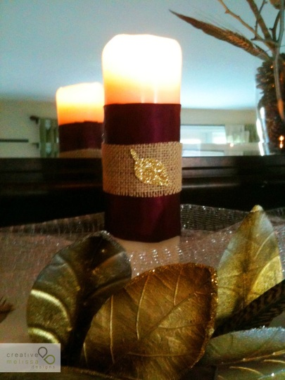gold, satin ribbon on candle